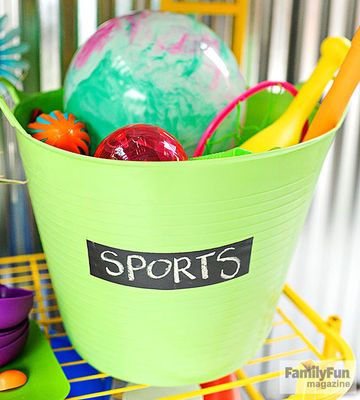 "Green bucket labeled ""SPORTS"""