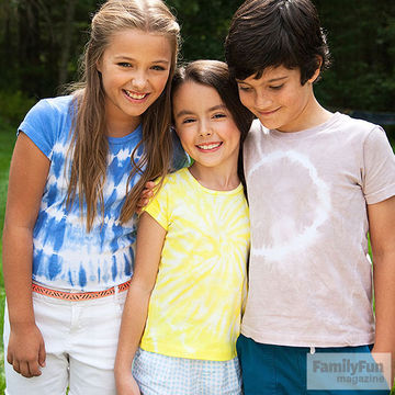 3 kids wearing tie-dyed shirts