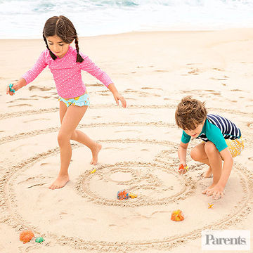 child playing sand games