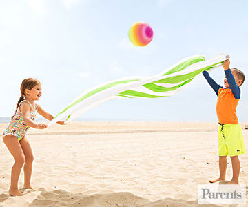 kids playing blanket bounce