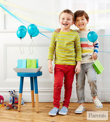 Two boys with gift bags