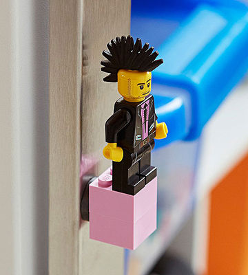 Mohawked Lego figure and pink block