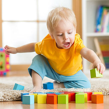 toddler playing wooden blocks
