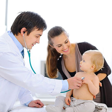 doctor checking baby's heartbeat