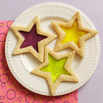 Three Stained Glass star cookies on plate