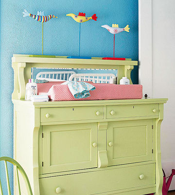 Birds over green changing table