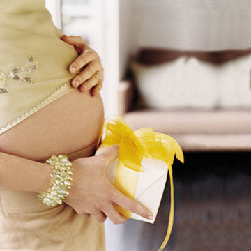 pregnant woman holding gift