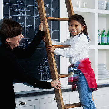 Girl on ladder with mom