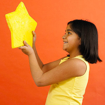 child holding plaster of paris star