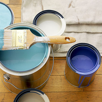 blue and white paint in cans