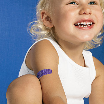 girl with purple bandaid on arm