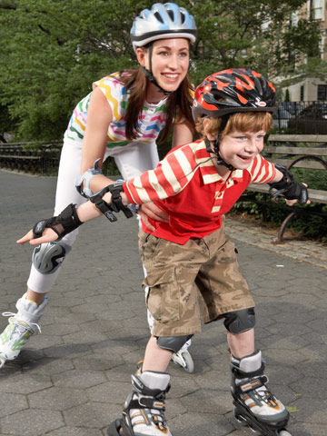 Mother and son rollerblading