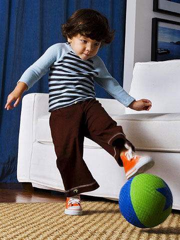 toddler kicking a ball
