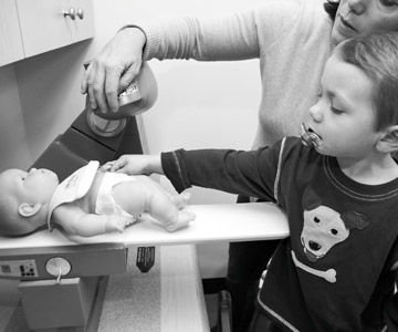A doll getting a CAT-scan