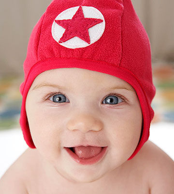 Cute baby wearing red hat