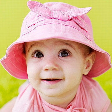 Cute baby girl wearing pink hat