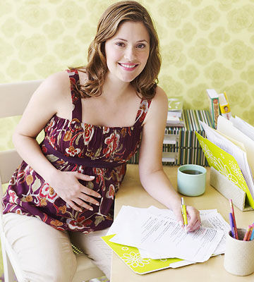 pregnant woman organizing paperwork