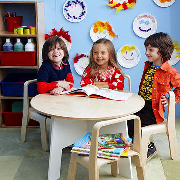 three preschoolers sitting at table