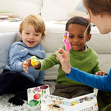 children sharing toys