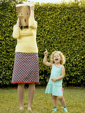 child saying something embarrassing to mother