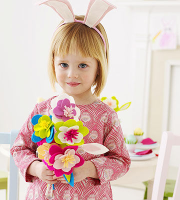 girl holding felt flower bouquet