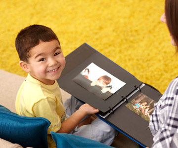 boy looking at photo album