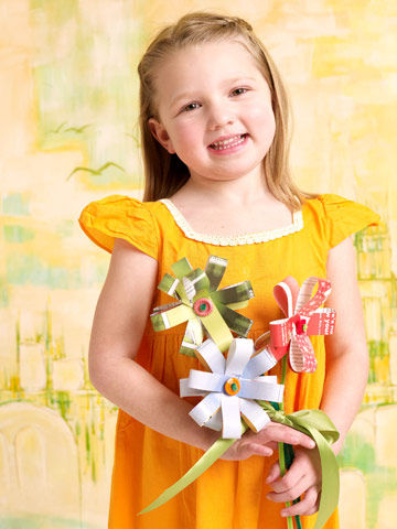 girl holding paper flowers