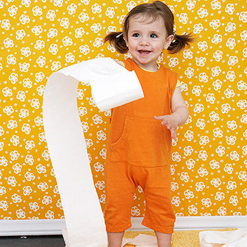 child throwing toilet paper