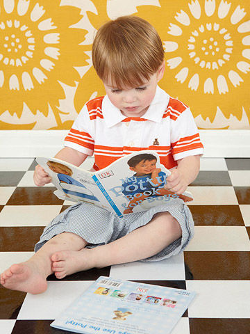 Boy reading potty training book