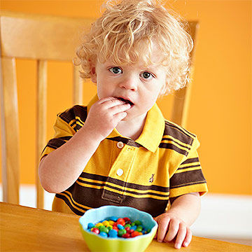 Toddler with candy bowl
