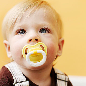 toddler using pacifier
