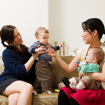 mothers playing with their babies