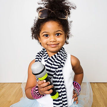 child holding microphone