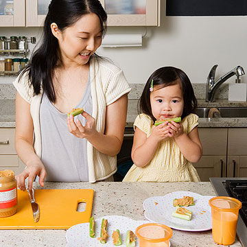 mother and child eating healthy snack