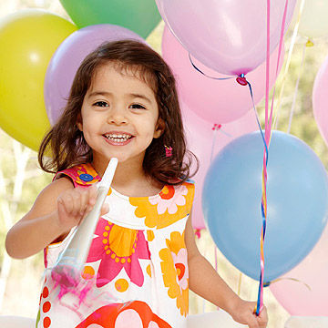 child holding balloons