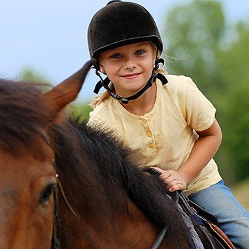 child horseback riding