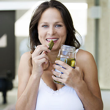 pregnant woman eating a pickle