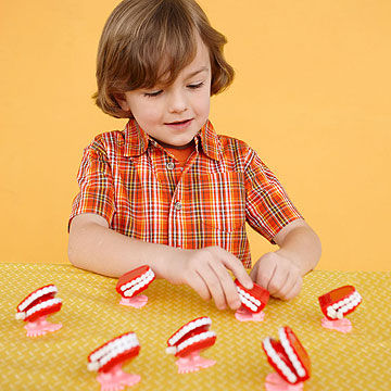 child playing with fake teeth toys