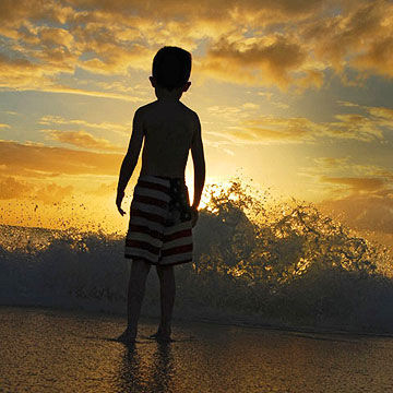Child watching sunset