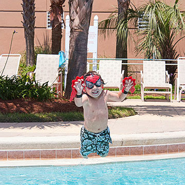 Child jumping in pool