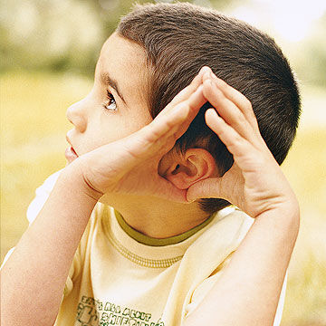 boy listening for sounds
