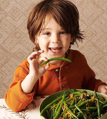boy eating green beans