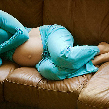 pregnant woman resting on couch