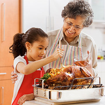 child helping grandmother with turkey