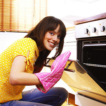 Woman looking in oven
