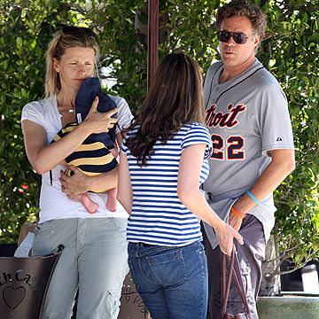 Will Ferrell and wife, Viveca Paulin, with baby Axel