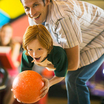 Father and son bowling