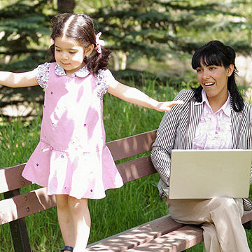 working mother at park with daughter
