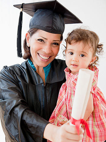 mother holding out her new degree