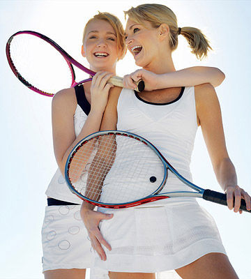 mother daughter playing tennis